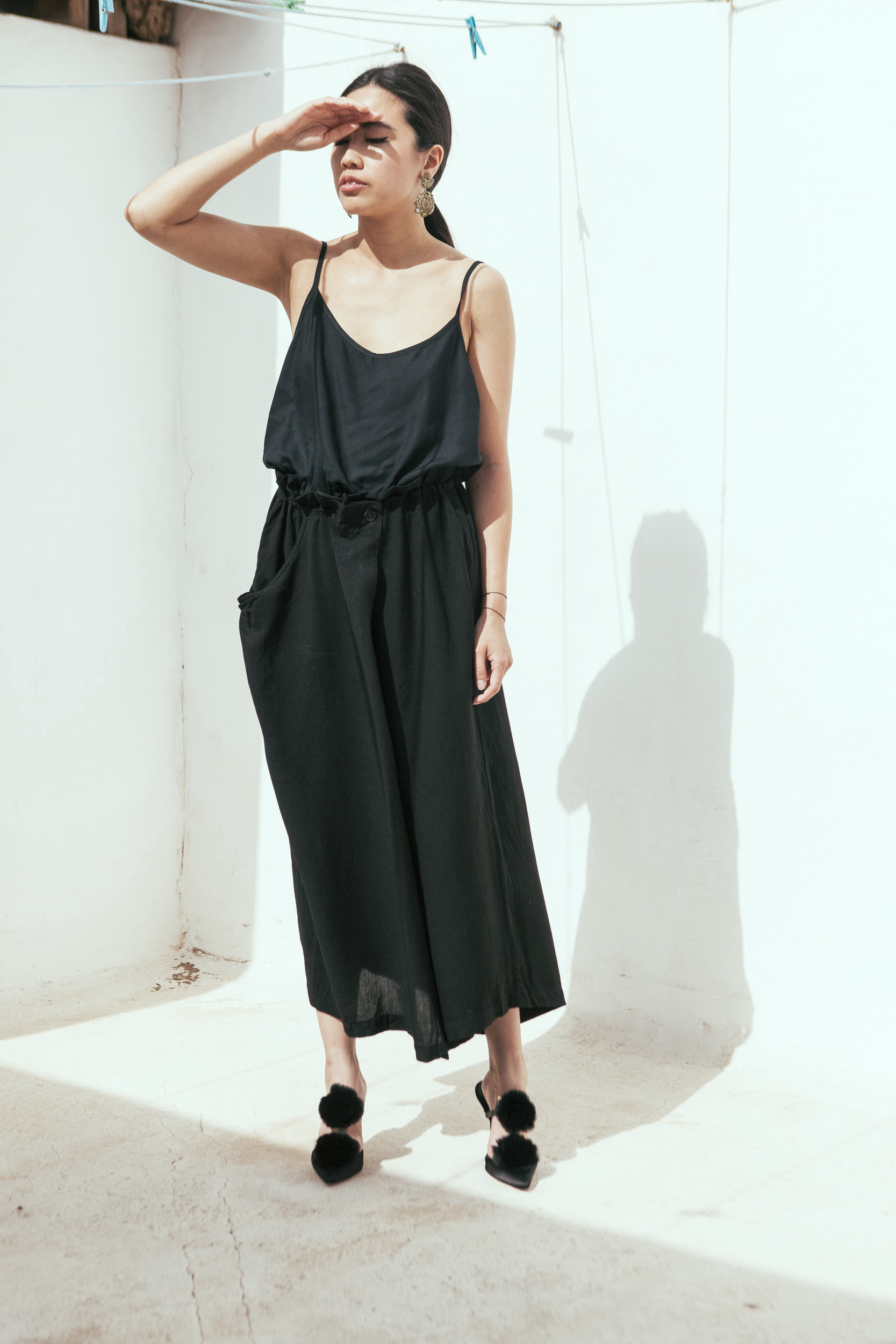 I heart Alice Looks: Black Top, Yohji Yamamoto Pants & Manolo Blahnik Crespo Satin Pumps in Fuerteventura / Spain by Lina Zangers
